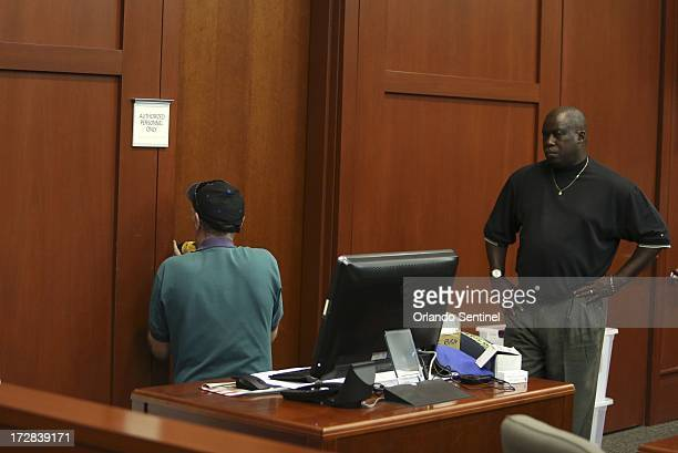 A locksmith drills into the door of the evidence room where the electronic lock had failed on Friday July 5 in the trial of George Zimmerman in...