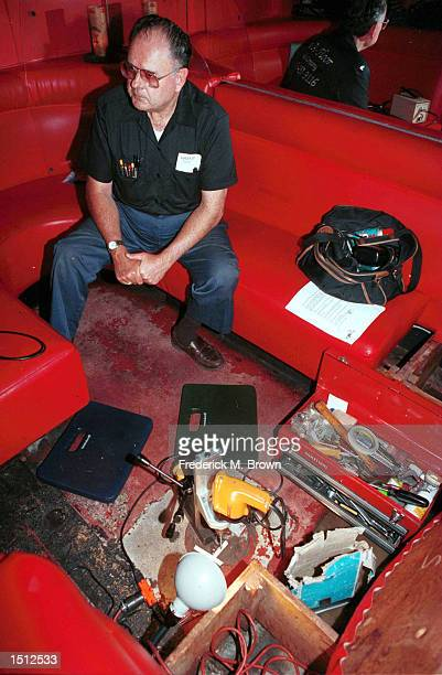 Locksmith Walt Marty Martin takes a break from drilling open a safe May 24 2000 at the Formosa Cafe in Los Angeles CA The safe belonged to 1940's...