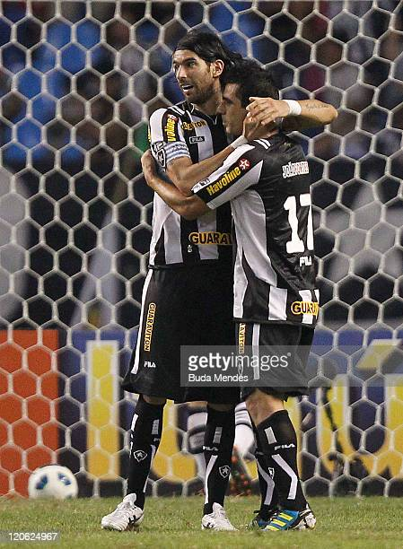 Loco Abreu and Herrera of Botafogo celebrate scored goal againist Vasco during a match as part of Serie A 2011 at Engenhao stadium on August 07, 2011...