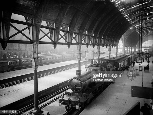 Locomotive at Paddington Station Praed Street Westminster London A steam locomotive stands on platform 8 while the driver and porters pose next to...