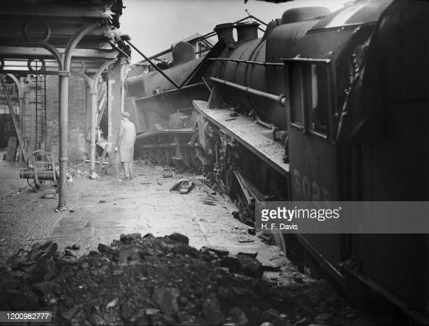 A locomotive buried in the refreshments room on the platform at Bletchley railway station Buckinghamshire the day after the Bletchley Rail Crash 14th...