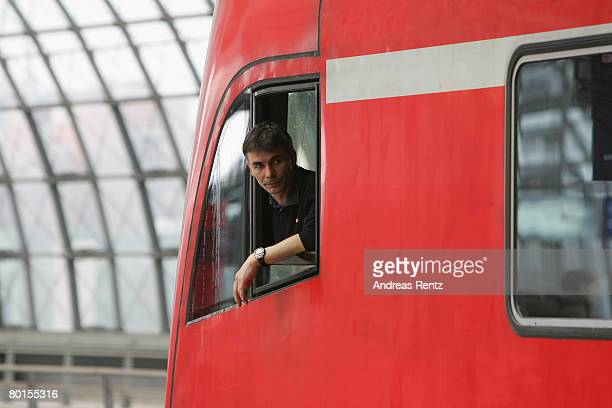 A locomotive driver of German state railways Deutsche Bahn is seen at the Central Station on March 7 2008 in Berlin Germany The German union of train...
