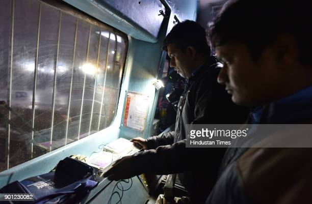 Locomotive driver using Fog Safe device so as to get prewarning about the approaching signals in heavy fog Conditions at New Delhi Railway Station on...
