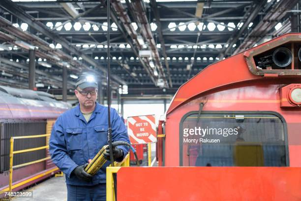 Locomotive engineer working in train works