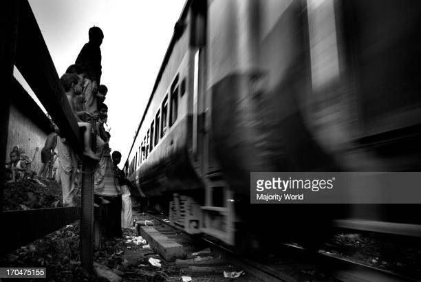 A locomotive master says that they have to drive through the trackside slums with extra caution which often delays their schedule 'We drive slowly...