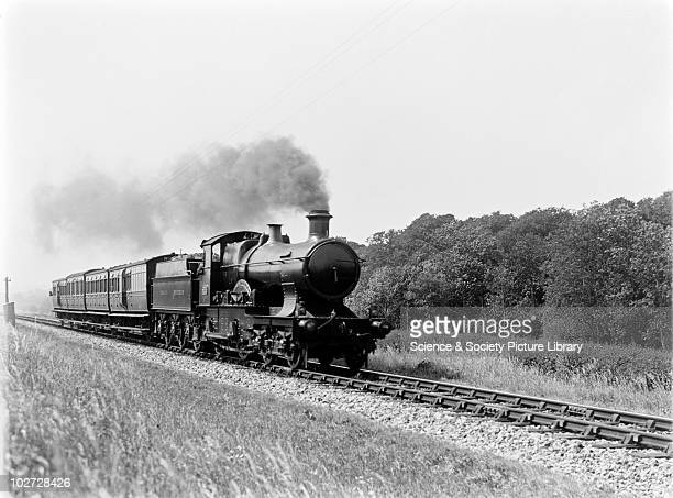 GWR locomotive no 3444 'Cardiff' Great Western Railway 440 Bulldog class locomotive no 3444 'Cardiff' down express at Landkey with 4 coaches all 4...