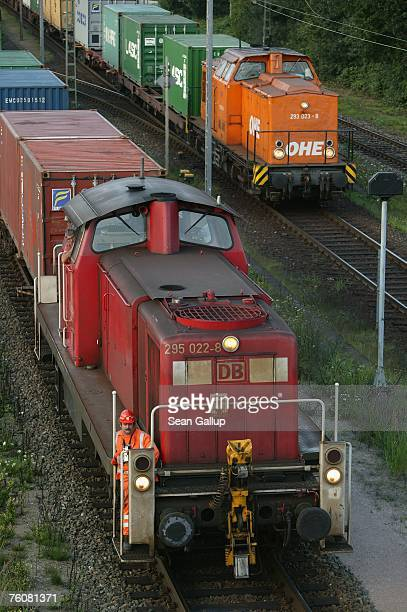 A locomotive of German rail carrier Deutsche Bahn pulls a cargo load at the main container port August 13 2007 in Hamburg Germany Mediators Heiner...