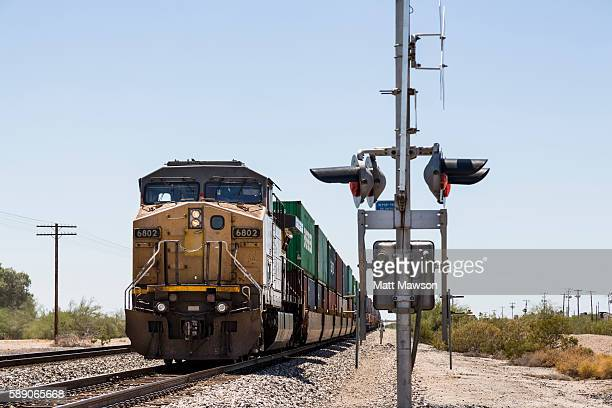 locomotive pulling goods passing through gila bend arizona usa - railroad car stock pictures, royalty-free photos & images