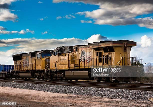 Locomotive pulling goods passing through Gila Bend Arizona USA