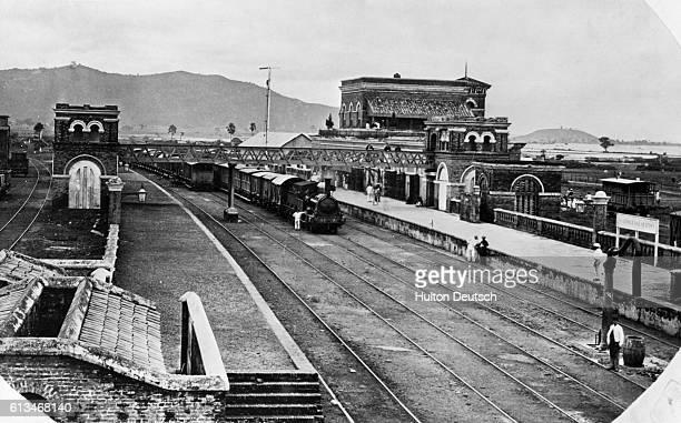 A locomotive pulls into a railway station near Calcutta in 1867