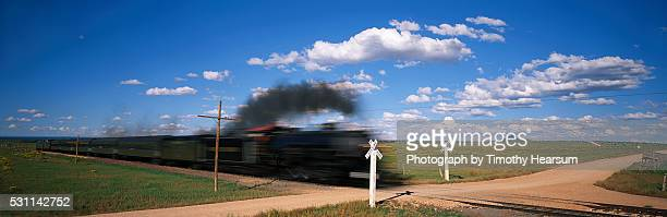 locomotive speeding through grand canyon railroad crossing - timothy hearsum ストックフォトと画像