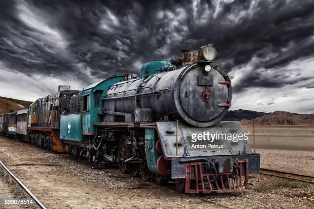 locomotive train in wadi rum desert, jordan - steam train stock pictures, royalty-free photos & images