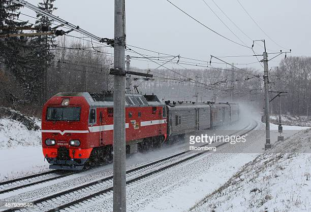 A locomotive travels along snow covered tracks on the TransSiberian railroad in the Kemerovo region of Siberia near Yashkino Russia on Friday Oct 24...