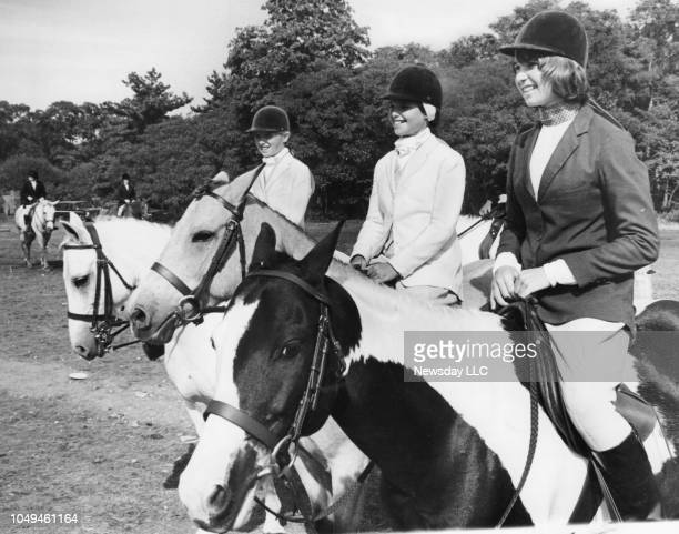 Mary Courtney Kennedy age 9 Maria Shriver age 10 and Kathleen Kennedy age 15 sit on their horses at the Piping Rock Club in Locust Valley New York on...
