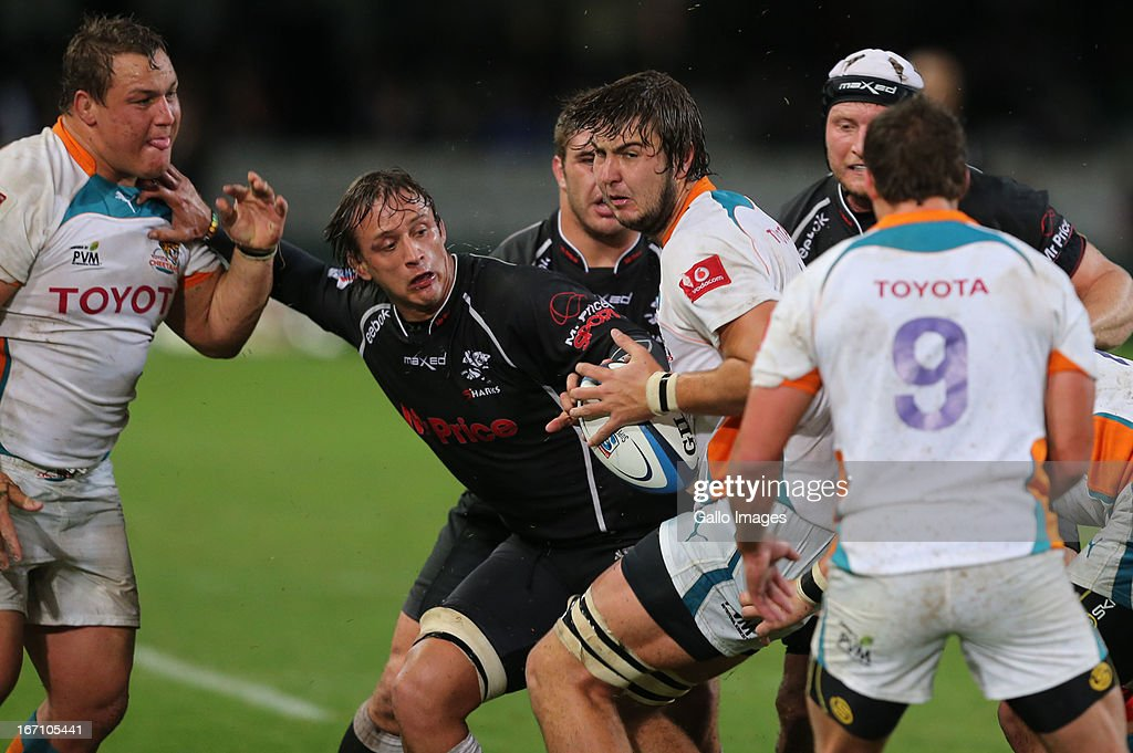 Lodewyk de Jager gets the ball away from Anton Bresler during the Super Rugby match between The Sharks and Toyota Cheetahs from Kings Park on April 20, 2013 in Durban, South Africa.