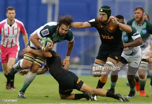 Lodewyk De Jager of Bulls is tackled by Tomas Cubelli of Jaguares during the Super Rugby Rd 2 match between Jaguares and Bulls at Jose Amalfitani...