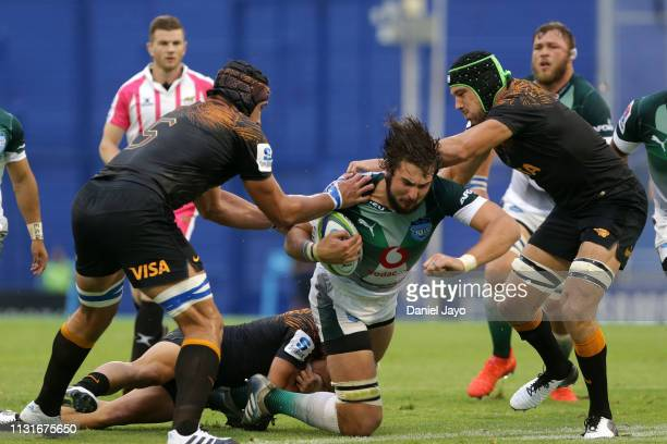 Lodewyk De Jager of Bulls is tackled by Tomas Lavanini and Guido Petti Pagadizaval of Jaguares during the Super Rugby Rd 2 match between Jaguares and...