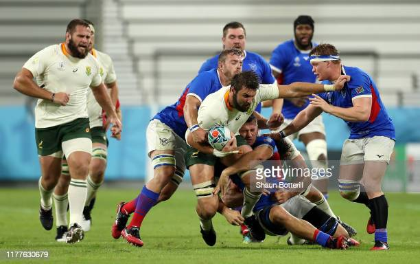 Lodewyk de Jager of South Africa attempts to break through the Namibia defense during the Rugby World Cup 2019 Group B game between South Africa and...