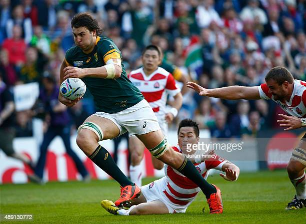 Lodewyk De Jager of South Africa breaks clear of the Japan defence to sacore his team's third try during the 2015 Rugby World Cup Pool B match...