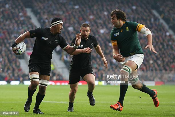 Lodewyk De Jager of South Africa comes in to tackles Jerome Kaino of the New Zealand All Blacks during the 2015 Rugby World Cup Semi Final match...