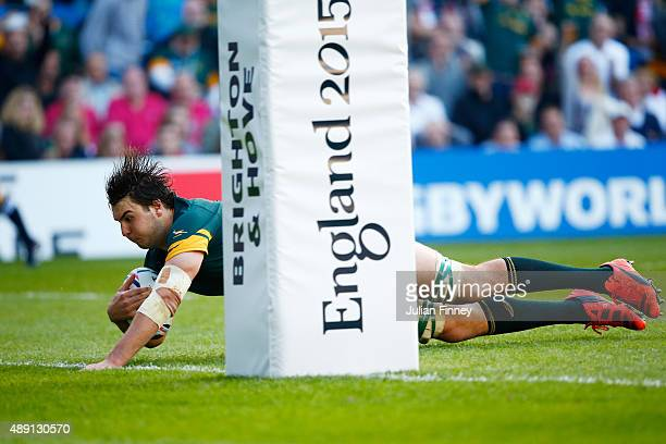 Lodewyk De Jager of South Africa dives over to score his team's third try during the 2015 Rugby World Cup Pool B match between South Africa and Japan...