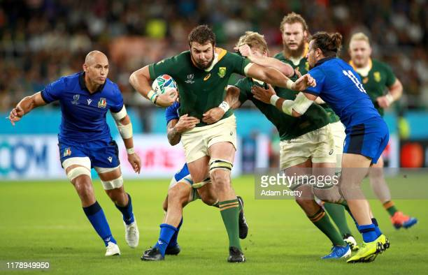 Lodewyk De Jager of South Africa is tackled by Jayden Hayward and Michele Campagnaro of Italy during the Rugby World Cup 2019 Group B game between...