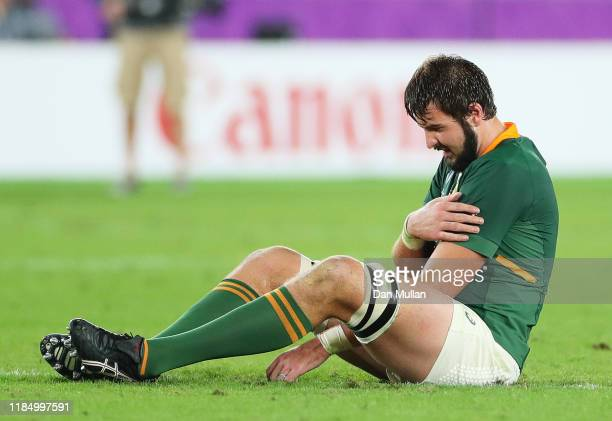Lodewyk de Jager of South Africa reacts as he holds his arm during the Rugby World Cup 2019 Final between England and South Africa at International...