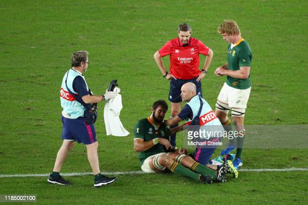 Lodewyk de Jager of South Africa receives medical treatment during the Rugby World Cup 2019 Final between England and South Africa at International...