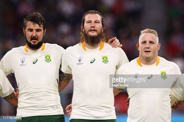 Lodewyk de Jager RG Snyman and Vincent Koch of South Africa line up for the national anthems prior to the Rugby World Cup 2019 Group B game between...