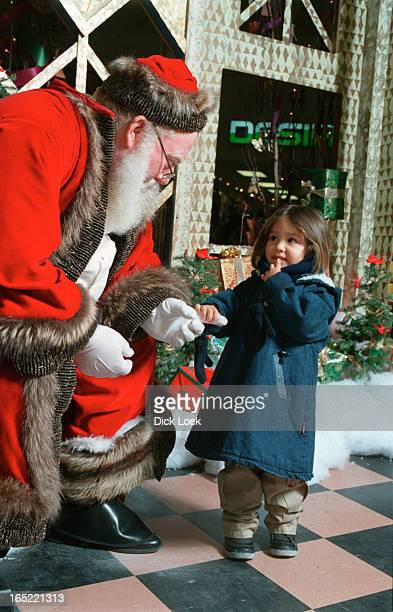 loek Dufferin Mall Santa meets with the kidsCarla Pola 3 walked right in and gazed at Santa and was brave enough to touch his hand *cap