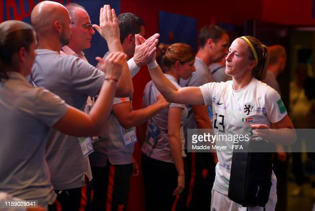 Loes Geurts of the Netherlands high fives a member of the backroom staff in the tunnel prior to the 2019 FIFA Women's World Cup France Quarter Final...