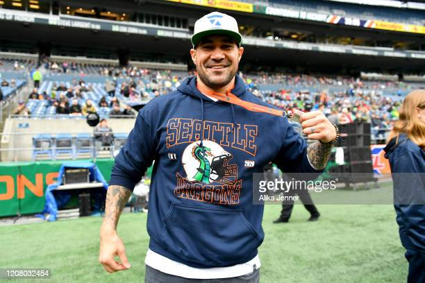 Lofa Tatupu a former NFL linebacker poses for a photo on the sidelines before the game between the Seattle Dragons and the Dallas Renegades at...