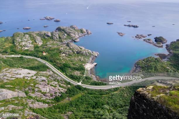 Lofoten coastline and road leading to Svolvaer seen from Tjeldbergtind, Lofoten, Norway
