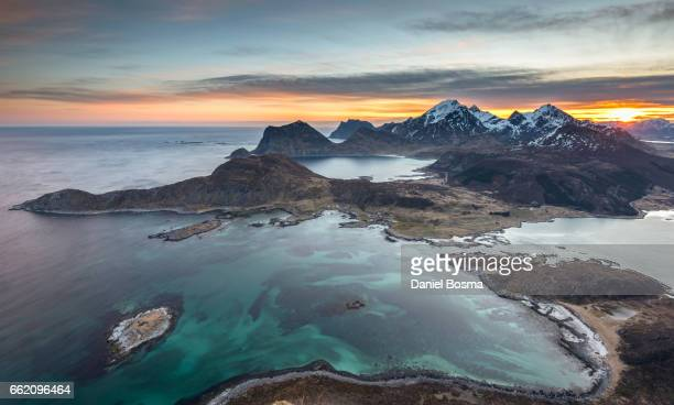 Lofoten islands during sunrise seen from a mountain called Offersøykammen
