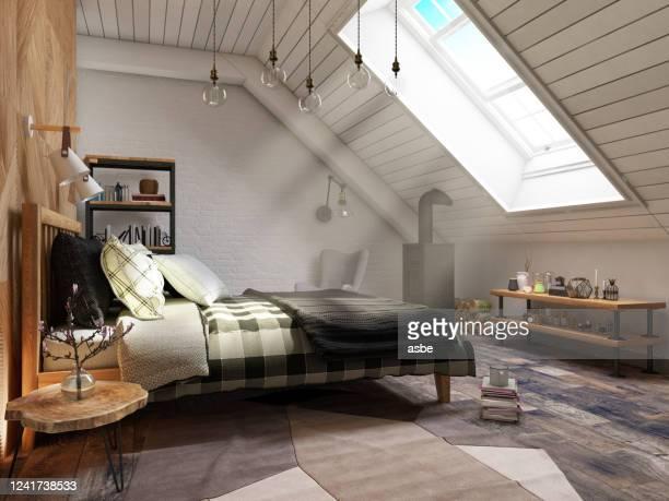 camera da letto loft con sunbeam - loft foto e immagini stock