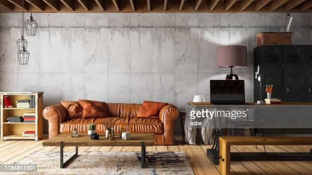 interni loft con divano in pelle - loft foto e immagini stock