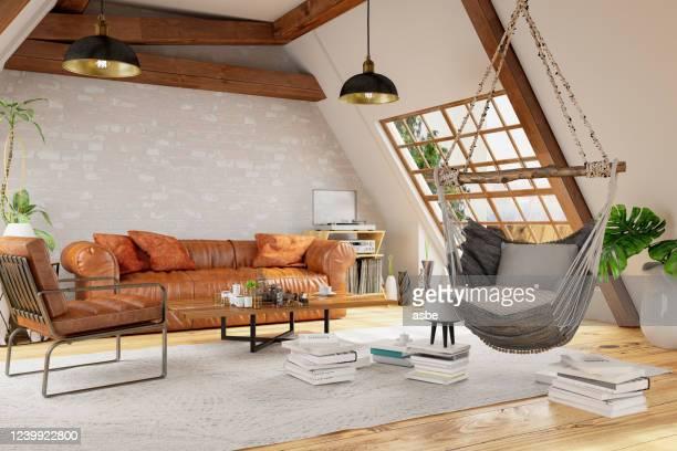 camera loft con amaca e mobili - loft foto e immagini stock