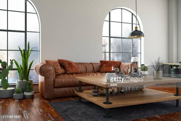loft zimmer mit sofa und windows - couchtisch stock-fotos und bilder