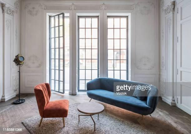 loft studio apartment in a classic style - ソファ 無人 ストックフォトと画像