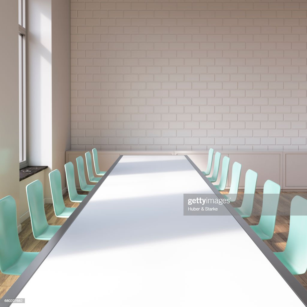 loft with conference table and view at skyline : Stock Photo