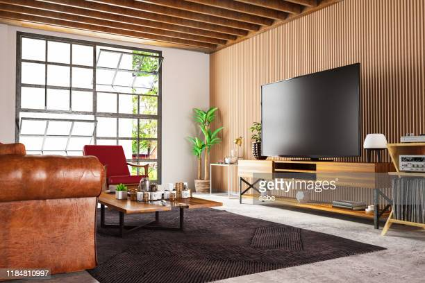 loft wooden room with television set - television set stock pictures, royalty-free photos & images