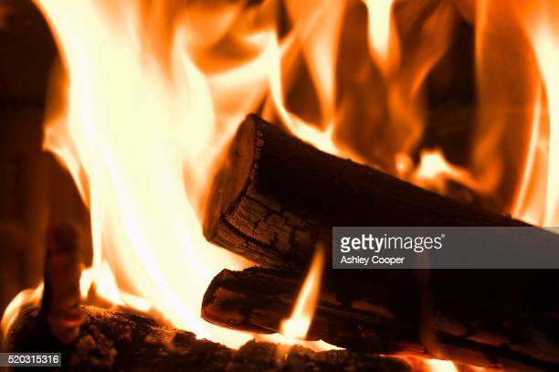 log burning in stove - burning stock pictures, royalty-free photos & images