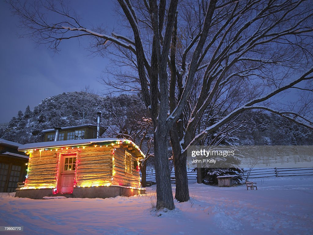 Log cabin decorated with Christmas lights in snow at night  Stock Photo & Log Cabin Decorated With Christmas Lights In Snow At Night Stock ... azcodes.com