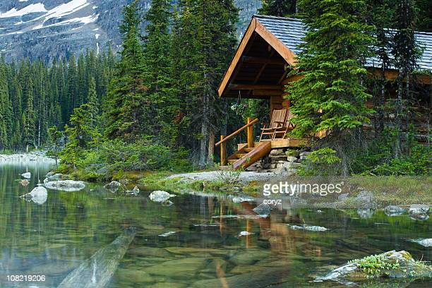 log cabin hidden in the trees by the lake ohara in canada - lake stock pictures, royalty-free photos & images