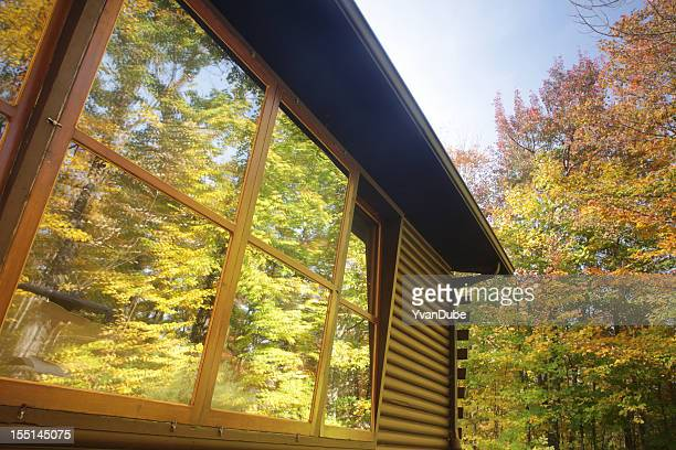 log cabin window reflection - eastern townships stock pictures, royalty-free photos & images
