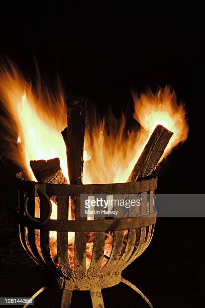 Log fire roaring away in decorative steel brasier. Royal Malewane Private Game Lodge, situated in the world famous Sabi Sand Game Reserve, bordering the Kruger National Park. South Africa.