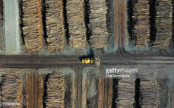 A log grapple wheel loader moves and stacks logs at the Sun Mountain Lumber log yard September 12 2019 in Deer Lodge Montana According to the 2017...
