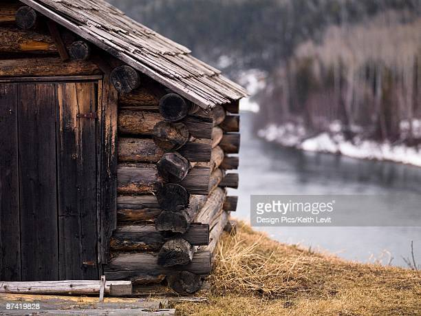 Log home along a river in British Columbia, Canada