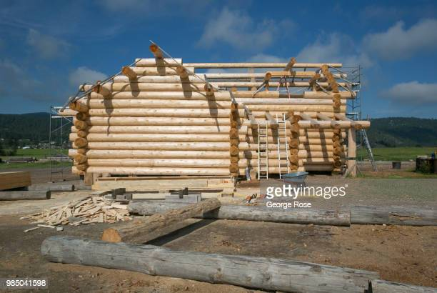 A log home made of customcut cedar trees is being constructed at the Montana Log Homes manufacturing site before being delivered and reconstructed at...