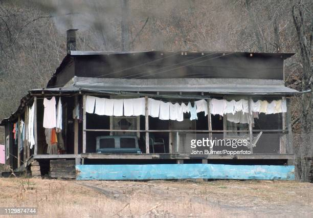 A log house with laundry hanging under the porch Pike County Kentucky US 1967